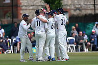 Simon Harmer of Surrey is congratulated by his team mates after taking the wicket of Scott Borthwick during Surrey CCC vs Essex CCC, Specsavers County Championship Division 1 Cricket at Guildford CC, The Sports Ground on 11th June 2017