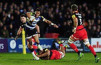 Anthony Watson of Bath Rugby takes on the Saracens defence. Aviva Premiership match, between Bath Rugby and Saracens on April 1, 2016 at the Recreation Ground in Bath, England. Photo by: Patrick Khachfe / Onside Images