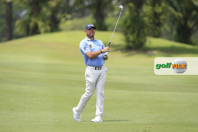 Lee Westwood (ENG) in actionon the 2nd fairway during Round 1 of the Maybank Championship at the Saujana Golf and Country Club in Kuala Lumpur on Thursday 1st February 2018.<br /> Picture:  Thos Caffrey / www.golffile.ie<br /> <br /> All photo usage must carry mandatory copyright credit (© Golffile | Thos Caffrey)