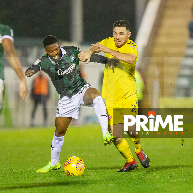 Joel Grant of Plymouth Argyle battles against Lewis Coyle of Fleetwood Town during the Sky Bet League 1 match between Plymouth Argyle and Fleetwood Town at Home Park, Plymouth, England on 25 November 2018. Photo by Mark Hawkins / PRiME Media Images.