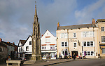 Crown Hotel and market cross in historic Market Place, Glastonbury, Somerset, England