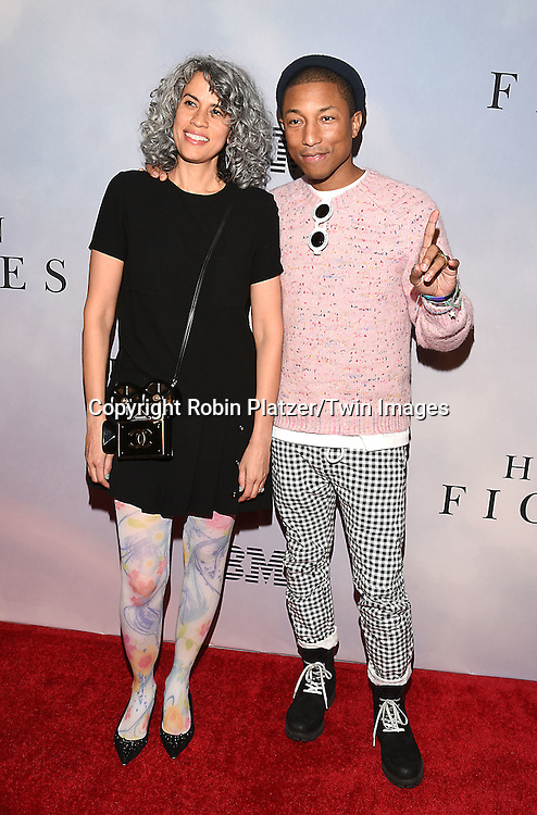 producer Mimi Valdes and Pharrell Williams attends &quot;Hidden Figures&quot; Special Screening on December 10, 2016 at SVA Theatre in New York, New York, USA.<br /> <br /> photo by Robin Platzer/Twin Images<br />  <br /> phone number 212-935-0770