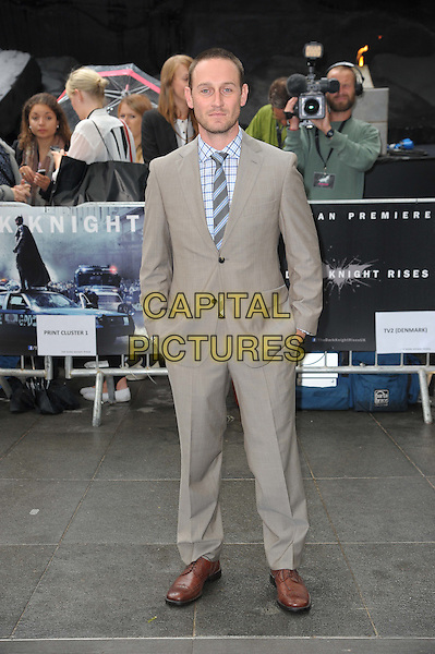 Josh Stewart.'The Dark Knight Rises' European premiere at Odeon Leicester Square cinema, London, England..18th July 2012.full length grey gray suit blue check shirt hands in pockets .CAP/CAS.©Bob Cass/Capital Pictures.