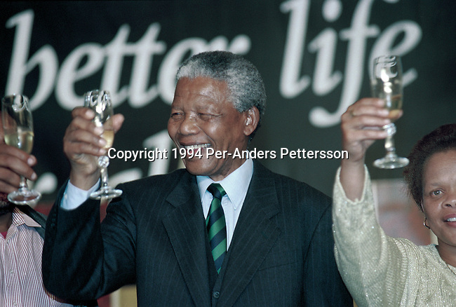 JOHANNESBURG, SOUTH AFRICA - MAY 2: Former South African president Nelson Mandela drinks champagne at a victory party held at Carlton Hotel on May 2, 1994 in Johannesburg, South Africa. The historic democratic election was held on April 27, 1994 and Mr. Mandela and his party, the African National Congress, won. Mr. Mandela became the first black democratic elected president in South Africa. He retired from office after one term in June 1999. (Photo by Per-Anders Pettersson).
