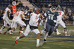 New Mexico quarterback Tevaka Tuioti (8) looks to throw as he is chased by Nevada's Dom Peterson (99) in the second half of an NCAA college football game in Reno, Nev., Saturday, Nov. 2, 2019. (AP Photo/Tom R. Smedes