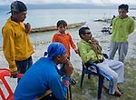 A group of Kuna men and boys prepare to practice a traditional dance on Isla Pelikano, San Blas Islands, Kuna Yala, Panama