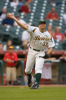 Shawn Tolleson #33 of the Baylor Bears makes a throw to first base versus the Houston Cougars in the 2009 Houston College Classic at Minute Maid Park February 27, 2009 in Houston, TX.  The Bears defeated the Cougars 3-2. (Photo by Brian Westerholt / Four Seam Images)