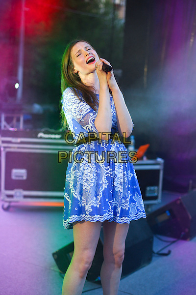 Sophie Ellis Bextor.Presentation of the TV channel 'Friday', Hermitage Garden, Moscow,.Russia, 7th August 2012..music live on stage performing performs concert gig half length blue lace dress white microphone singing belt black.CAP/PER/AS.©AS/PersonaStars/CapitalPictures