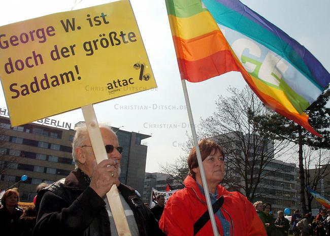 Protest gegen US-Krieg in Berlin<br /> Etwa 15.000 Menschen demonstrierten am Sonnabend den 12. April 2003 in Berlin gegen des US-Krieg gegen den Irak. Motto der Demonstration: &quot;Friede statt Besatzung&quot;. Die Demonstration zog als eine Art ruhiger und beschaulicher Friedens-Spaziergang durch den Tiergarten zum Brandenburger Tor.<br /> Hier: Demonstranten mit einem der Plakat der Globalisierungskritiker attac aus Hamburg mit der Parole: &quot;George W. ist doch der groesste Saddam!&quot;.<br /> 12.4.2003, Berlin<br /> Copyright: Christian-Ditsch.de<br /> [Inhaltsveraendernde Manipulation des Fotos nur nach ausdruecklicher Genehmigung des Fotografen. Vereinbarungen ueber Abtretung von Persoenlichkeitsrechten/Model Release der abgebildeten Person/Personen liegen nicht vor. NO MODEL RELEASE! Nur fuer Redaktionelle Zwecke. Don't publish without copyright Christian-Ditsch.de, Veroeffentlichung nur mit Fotografennennung, sowie gegen Honorar, MwSt. und Beleg. Konto: I N G - D i B a, IBAN DE58500105175400192269, BIC INGDDEFFXXX, Kontakt: post@christian-ditsch.de<br /> Bei der Bearbeitung der Dateiinformationen darf die Urheberkennzeichnung in den EXIF- und  IPTC-Daten nicht entfernt werden, diese sind in digitalen Medien nach &sect;95c UrhG rechtlich geschuetzt. Der Urhebervermerk wird gemaess &sect;13 UrhG verlangt.]