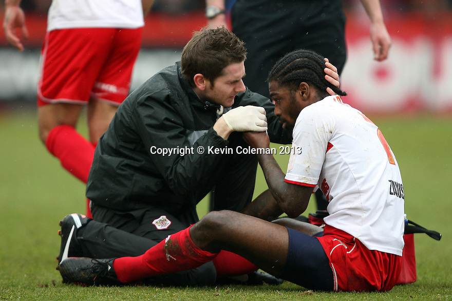 Anthony Grant of Stevenage is treated by physio Paul Dando. Stevenage v Yeovil Town- npower League 1 -  Lamex Stadium, Stevenage - 13th April, 2013. © Kevin Coleman 2013.. . . . .. . . .  . . .  .