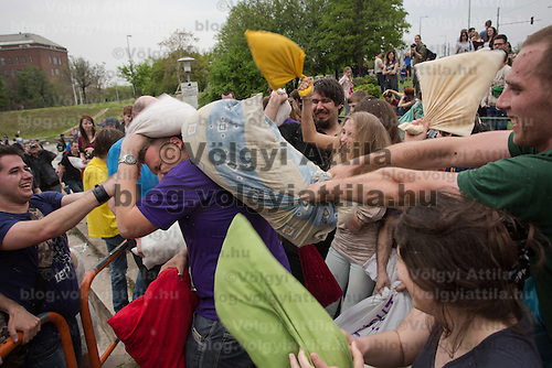 Participants enjoy a public pillow fight in Budapest, Hungary on April 05, 2014. ATTILA VOLGYI
