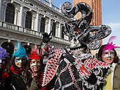 Venice, Italy. People dress in costumes and wear masks as they celebrate the 2015 Carnival in Venice, Italy.