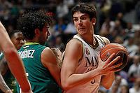 01.04.2012 SPAIN - ACB match played between Real Madrid vs Unicaja  at Palacio de los deportes stadium. The picture show Berni Rodriguez (Unicaja) and Carlos Suarez (Spanish small forward of Real Madrid)