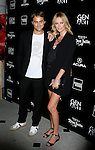 """BEVERLY HILLS, CA. - September 22: Writer/director Stuart Townsend and actress Charlize Theron arrive at a special screening of """"Battle in Seattle"""" held at the Clarity Theater on Monday September 22, 2008 in Beverly Hills, California."""