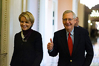 United States Senate Majority Leader Mitch McConnell (Republican of Kentucky) gives a thumbs up as he walks with a staffer from his office to the Senate chamber for a procedural vote to move forward with voting on the Republican proposed tax reform bill at the United States Capitol in Washington, D.C. on Friday, December 1, 2017.<br /> Credit: Alex Edelman / CNP /MediaPunch