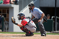 Gwinnett Braves catcher Blake Lalli (15) sets a target as home plate umpire Ryan Additon looks on during the game against the Charlotte Knights at BB&T BallPark on May 22, 2016 in Charlotte, North Carolina.  The Knights defeated the Braves 9-8 in 11 innings.  (Brian Westerholt/Four Seam Images)