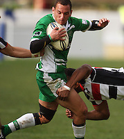 Manawatu's Aaron Cruden is tied up by Counties defenders during the Air NZ Cup rugby match between Manawatu Turbos and Counties-Manukau Steelers at FMG Stadium, Palmerston North, New Zealand on Sunday, 2 August 2009. Photo: Dave Lintott / lintottphoto.co.nz