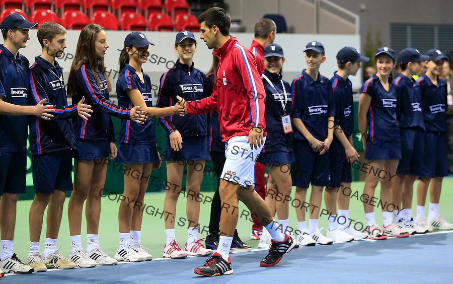 Davis Cup 2014 first round<br /> Srbija v Hrvatska<br /> Novak Djokovic and Nenad Zimonjic-Serbia v Franko Skugor and Marin Draganja doubles dublovi<br /> Novak Djokovic with ball kids<br /> Kraljevo, 07.03.2015.<br /> Foto: Srdjan Stevanovic/Starsportphoto.com&copy;