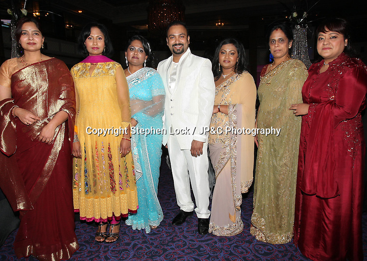Lycamobile Chairman Subas Allirajah and his wife Prema (3rd right)  and some of his guests at his 40th birthday party held in London, Friday, 2nd March 2012.  Photo by: Stephen Lock / i-Images