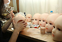June 23, 2010- Tokyo, Japan - A makeup artist adds a sense of realism to the Love Dolls by inserting eye lashes on the model heads at the Orient Industry factory in Tokyo, Japan, on June 23, 2010. Orient Industry is a 33-year-old company which is number one in Japan for producing over 1,000 Love Dolls annually, ranging in price from ¥90,000 to ¥700,000.