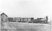 3/4 engineer's-side view of D&amp;RG American #17 with at least a three-car passenger train posing with her crews and passengers at the La Veta depot.<br /> D&amp;RG  La Veta, CO  1876-1888