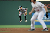 Simon Whiteman (10) of the Augusta GreenJackets hops into the air as a pitch is thrown in a game against the Greenville Drive on Thursday, August 29, 2019, at Fluor Field at the West End in Greenville, South Carolina. Augusta won, 11-0. (Tom Priddy/Four Seam Images)