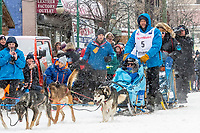 Ramey Smyth and team leave the ceremonial start line with an Iditarider and handler at 4th Avenue and D street in downtown Anchorage, Alaska on Saturday March 7th during the 2020 Iditarod race. Photo copyright by Cathy Hart Photography.com