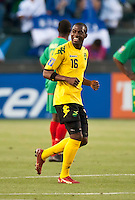 CARSON, CA – June 6, 2011: Jamaican Omar Daley (16) smiles at this bench following his goal during the match between Grenada and Jamaica at the Home Depot Center in Carson, California. Final score Jamaica 4 and Grenada 0.