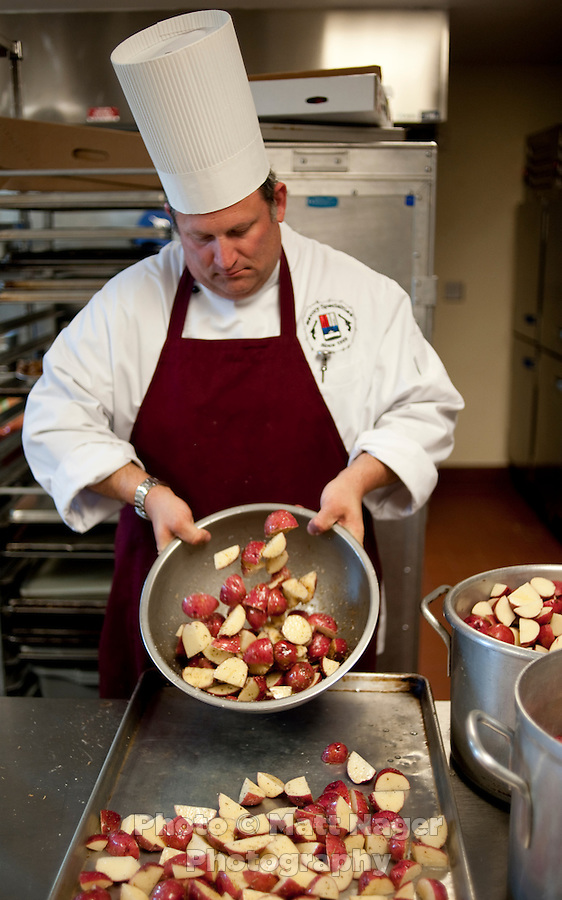 Potatoes are prepared for dinner by professional chef Ken Cobb (cq) prepares a prime rib dinner at Sigma Alpha Epsilon fraternity house on the Southern Methodist University campus in Dallas, Texas, Friday, january 20, 2011. Some high-end chefs have found professional salvation from an unlikely location: Fraternity Row. Cobb employs a pair of interns from the Dallas Culinary Institute, where he once served as lead instructor, to help him cook three meals every weekday for another pair of frat houses on SMU's campus...Matt Nager for The Wall Street Journal