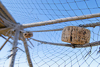 Old netting hanging from unused stockfish drying rack, Vestersand, Lofoten, Norway