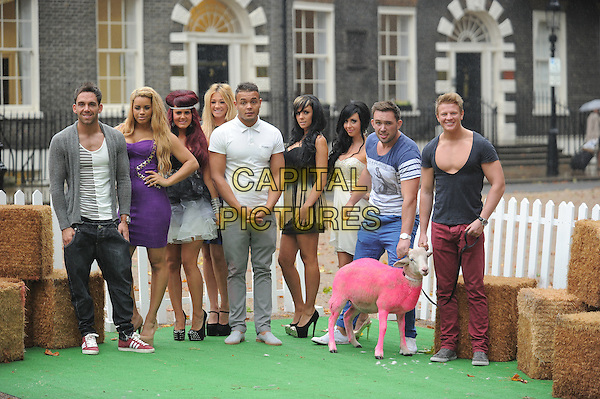 The Valleys cast - Aron Williams, Liam Powell, Nicole Morris, Lateysha grace, Jenna Jonathan, Natalee Harris, Carley Belmonte, Darren Chidgey, Leeroy Reed.'The Valleys' photocall , Bedford Sq.,  London, England..September 24th, 2012.full length blue grey gray white dress purple goat sheep dyed coat wool.CAP/CAS.©Bob Cass/Capital Pictures.