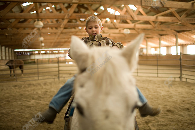 Stuart Walsh's son, Johnny, is enrolled at the Ranch for Kids, a therapeutic boarding school located near Eureka, Montana for adopted foreign children who are experiencing difficulties, such as adoption disruption, with their new U.S. families. Johnny currently lives with Joyce Sterkel, the founder of the ranch. Montana, March 1, 2008. ...