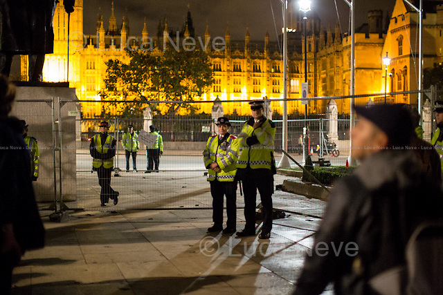 Day X - 26.10.2014 - Farewell To Parliament Square...<br /> <br /> London 17-26.10.2014. A day at the Parliament Square Occupy Democracy Camp in London. Protesters have been camping in Parliament Square since the 17th of October and they will leave on Sunday the 26th. Since the beginning of the direct action protesters have been battling with the MET Police and the Greater London Authority's Heritage Wardens (provided under private contract by AOS Security) over the specific bylaw which applies to a designated area immediately surrounding and including Parliament Square and which bans sleeping equipment. Several people have been arrested, including the Green Party's Baroness Jenny Jones, member of the London Assembly who was later &quot;de-arrested&quot;. In the meantime, numerous celebrities, politicians, experts, activists, and members of the public met for conferences and debates about various topics, from democracy to climate change, to the economic crisis, to corruption, to poetry and many more.<br /> <br /> For more information please click here: http://occupydemocracy.org.uk/ &amp; http://on.fb.me/12tuv79