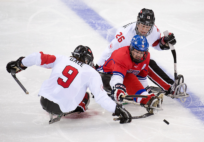 Sochi, RUSSIA - Mar 11 2014 -  Anthony Gale has the puck knocked off his stick as Canada takes on Czech Republic in Sledge Hockey at the 2014 Paralympic Winter Games in Sochi, Russia.  (Photo: Matthew Murnaghan/Canadian Paralympic Committee)