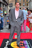 Craig Fairbrass<br /> The &quot;Bula Quo!&quot; UK film premiere, Odeon West End cinema, Leicester Square, London, England.<br /> July 1st, 2013<br /> full length suit pink shirt grey gray suit hands in pockets  <br /> CAP/BF<br /> &copy;Bob Fidgeon/Capital Pictures