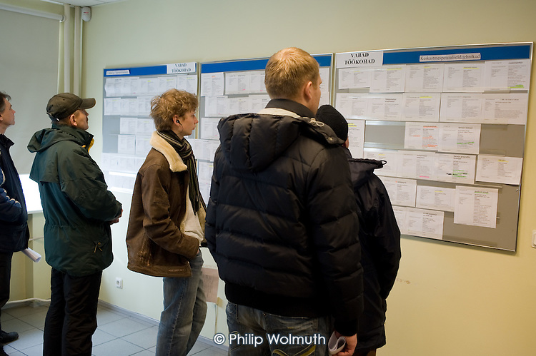 Men looking for work read through job vacancies at the Tallinn Labour Market Board (unemployment office).   Estonia has been badly hit by the banking crisis.