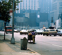 Pushing a cart full of pretzels. Series of images from New York between 1975 -1977. New York,USA.