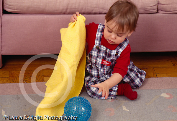 Piaget object permanence 10 month old baby boy finding ball hidden under blanket horizontal
