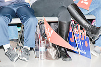 Campaign signs stand on the ground in the audience as Republican presidential candidate and former Florida governor Jeb Bush speaks at a town hall in Souhegan High School in Amherst, New Hampshire.