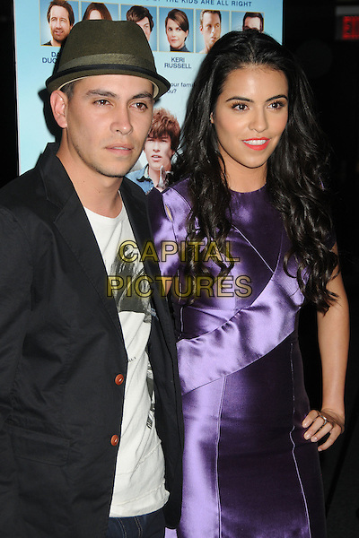 "Juan Carlos Segura, Olga Segura.""Goats"" Los Angeles Premiere held at the Landmark Theatre, Westwood, California, USA. .August 8th, 2012.half length  white top hat black suit jacket purple silk satin dress green.CAP/ADM/BP.©Byron Purvis/AdMedia/Capital Pictures."