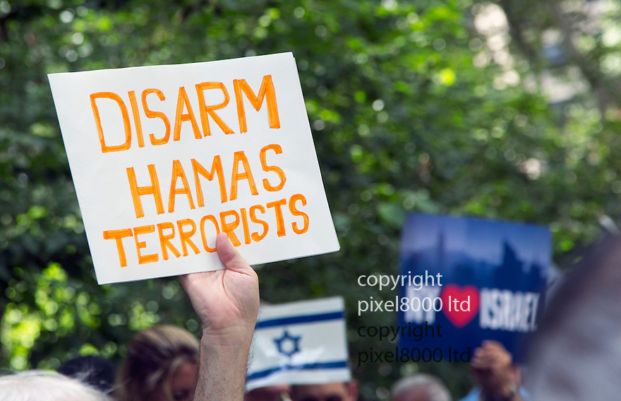 Pic shows: UN<br /> <br /> United Nations building in New York today where a huge pro Israeli rally of 10000 people was taking place.<br /> <br /> slogans included Kick Hamas Ass and Israel Has The Right To Defend Itself.<br /> <br /> Disarm Hamas<br /> <br /> <br /> <br /> Pic by Gavin Rodgers/Pixel 8000 Ltd