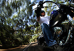 SAN DIEGO, CA - JULY 22:  Helmut Herb rides a  Harley Davidson Softtail through Elfin Forest during the Harley Davidson Release test ride for Stern Magazine on July 22 in San Diego, California. (Photo by Donald Miralle) *** Local Caption *** Helmut Werb