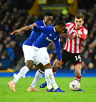 Lincoln City's Harry Toffolo vies for possession with Everton's Ademola Lookman, left, and Yerry Mina<br /> <br /> Photographer Andrew Vaughan/CameraSport<br /> <br /> Emirates FA Cup Third Round - Everton v Lincoln City - Saturday 5th January 2019 - Goodison Park - Liverpool<br />  <br /> World Copyright &copy; 2019 CameraSport. All rights reserved. 43 Linden Ave. Countesthorpe. Leicester. England. LE8 5PG - Tel: +44 (0) 116 277 4147 - admin@camerasport.com - www.camerasport.com
