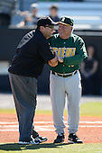 Siena Saints head coach Tony Rossi (40) talks with an umpire before a game against the Central Florida Knights at Jay Bergman Field on February 16, 2014 in Orlando, Florida.  UCF defeated Siena 9-6.  (Copyright Mike Janes Photography)
