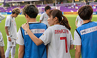 ORLANDO, FL - MARCH 05: Emi Nakajima #7 of Japan hugs a teammate during a game between Spain and Japan at Exploria Stadium on March 05, 2020 in Orlando, Florida.