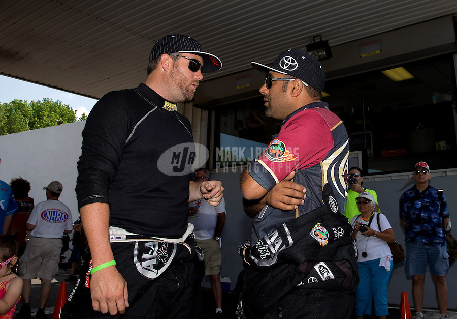 Jun. 2, 2013; Englishtown, NJ, USA: NHRA top fuel dragster driver Khalid Albalooshi (right) talks with Shawn Langdon during the Summer Nationals at Raceway Park. Mandatory Credit: Mark J. Rebilas-