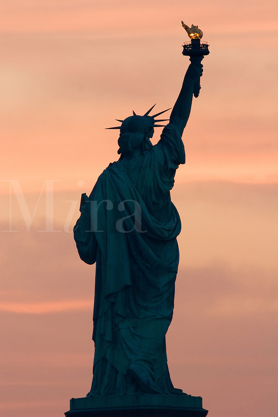 Sunrise and the Statue of Liberty.