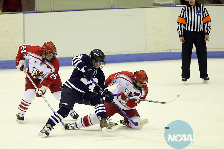 17 MAR 2007:  Middlebury College's Molly Vitt (8) steals the puck from Plattsburgh State's Keltie Jones (12)  and Sarah Samson (24)  during the Division III Women's Ice Hockey Championship held at the Stafford Arena on the Plattsburgh State University campus in Plattsburgh, N.Y.  Plattsburgh won the match 2-1 taking the Championship.  Todd Bissonette/NCAA Photos