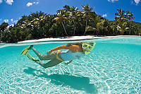 Snorkeler Jen Gibbud in the clear calm water at.Salomon Beach.Virgin Islands National Park.St. John, U.S. Virgin Islands