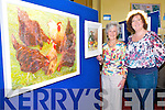 Painting Exhibition : Abbeyfeale artist Noranne Dennison with her daughter Maedhbh pictured with her paintings at the Library, Abbeyfeale during the Abbeyfeale Arts Assembly Week.